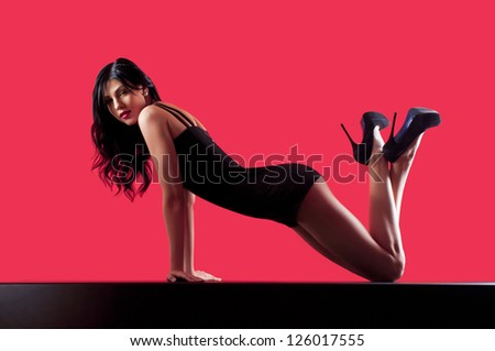 beautiful woman in a dark dress on the floor - stock photo