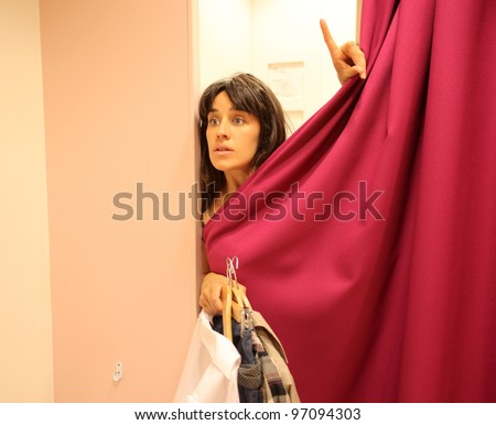 Beautiful woman in a dressing room - stock photo