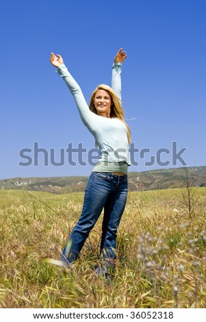 Beautiful woman in a field on a Spring day