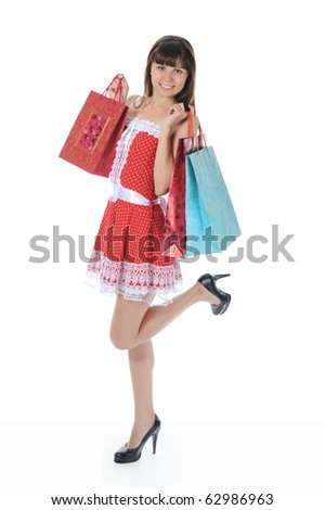 beautiful woman in a full-length with shopping bags. Isolated on white background