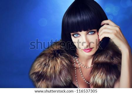 Beautiful woman in a fur coat. - stock photo