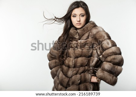 beautiful woman in a fur coat fashion - stock photo