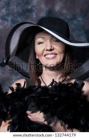 Beautiful woman in a hat with wide boards