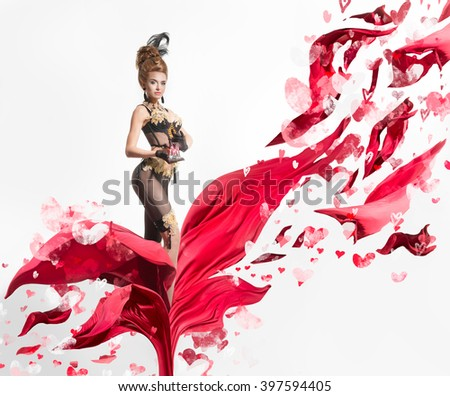 Beautiful woman in a lingerie on a flying red flower - stock photo