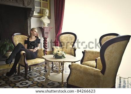Beautiful woman in a living room - stock photo