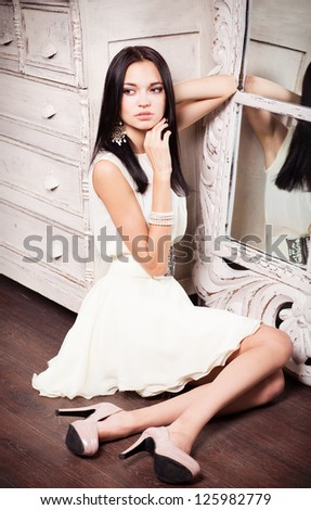 Beautiful woman in a luxury dress with belt - stock photo