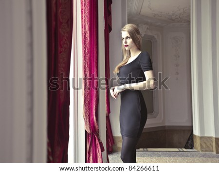 Beautiful woman in a luxury hotel - stock photo