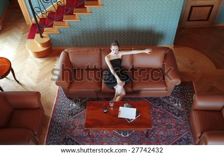 Beautiful woman in a luxury living room