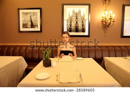 beautiful woman in a restaurant - stock photo