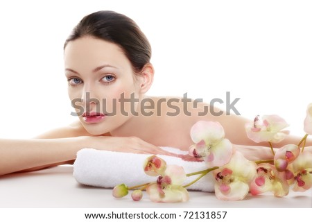 Beautiful woman in a spa. Space for text. - stock photo