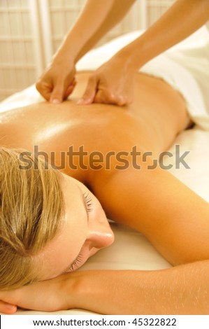 Beautiful woman in a spa with massage therapy - stock photo