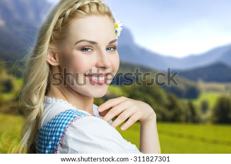 beautiful woman in a traditional bavarian dirndl - stock photo