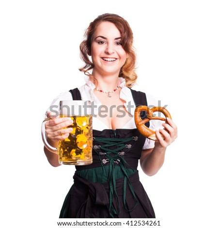 beautiful woman in a traditional bavarian dirndl with a beer - stock photo