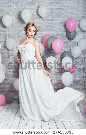 Beautiful woman in a wedding dress - stock photo