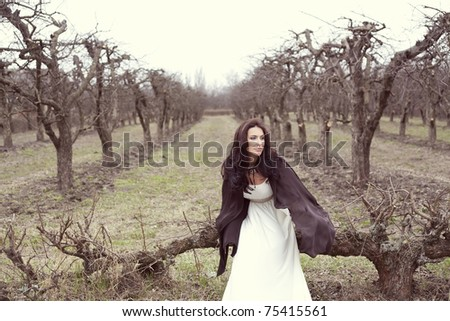 beautiful woman in a white dress in a fairy forest - stock photo