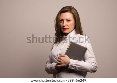 Beautiful woman in a white shirt holding a notebook documents business