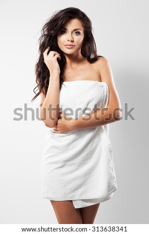 Beautiful woman in a white towel - stock photo