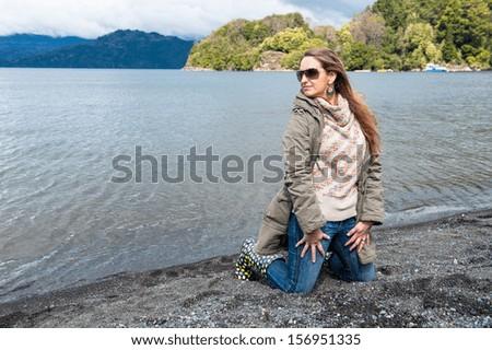 Beautiful woman in a winter beach - stock photo