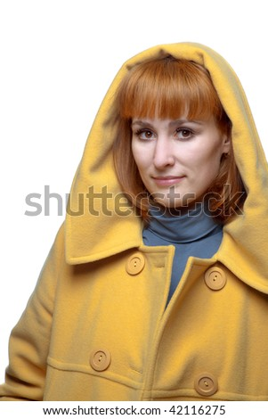 beautiful woman in a yellow coat - stock photo