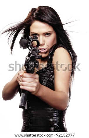 Beautiful woman in action pose as she aims a weapon through site, hair blowing.  Isolated against white background. - stock photo