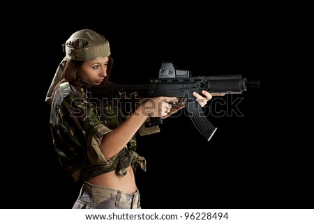 Beautiful woman in action pose, isolated on black - stock photo