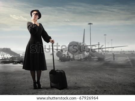 beautiful woman in airport - stock photo