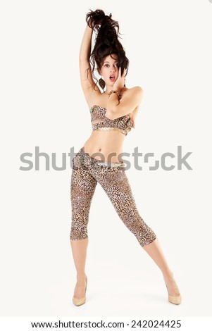 Beautiful woman in an animal print overall. - stock photo