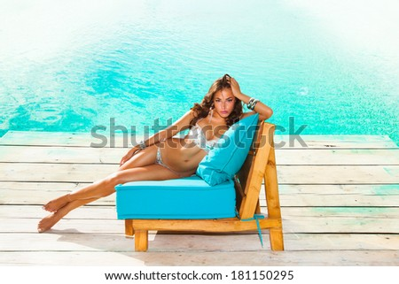 beautiful woman in  bikini  by the pool summer hot day - stock photo