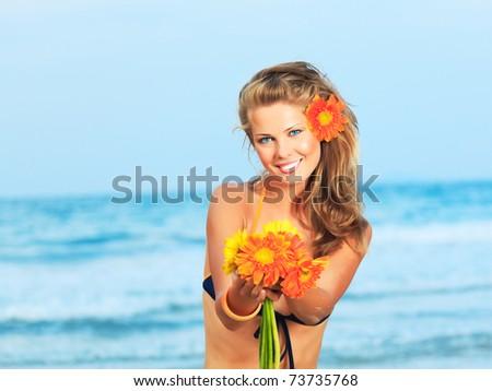 Beautiful woman in bikini on the beach - stock photo