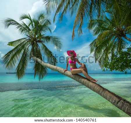 Beautiful woman in bikini on the Paradise island - stock photo