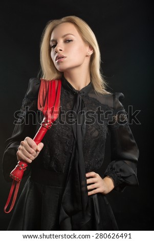 beautiful woman in biting red whip - stock photo
