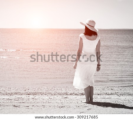 Beautiful woman in black and white with added sunlight effect - stock photo