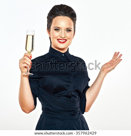 Beautiful woman in black evening dress isolated portrait with champagne, wine glass. Studio isolated portrait of young model. - stock photo
