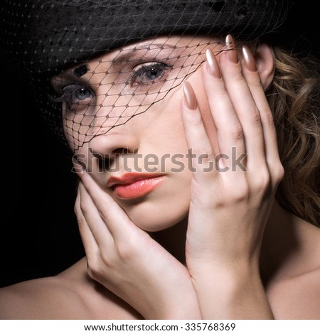 Beautiful woman in black hat with veil - stock photo