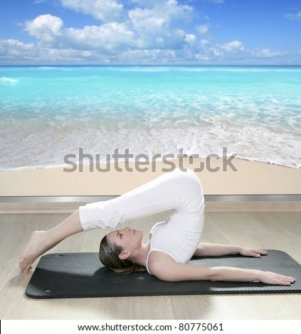 beautiful woman in black mat yoga in front a window view of tropical beach [Photo Illustration]