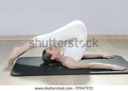 beautiful woman in black mat yoga in gym - stock photo