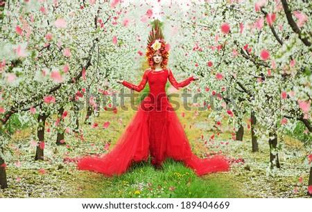 Beautiful woman in blooming garden - stock photo