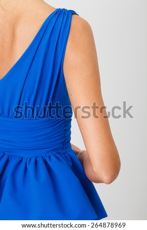 Beautiful Woman in Blue Dress on White