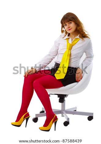 Beautiful woman in bright clothes in a chair - stock photo