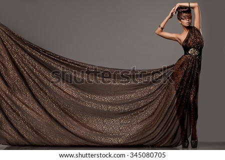 beautiful woman in brown dress - stock photo