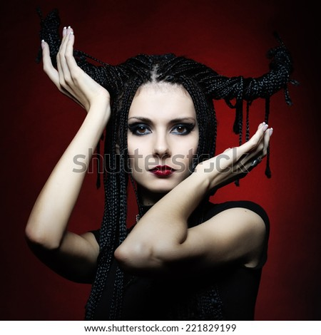 Beautiful woman in carnival costume. witch shape with Horns. - stock photo