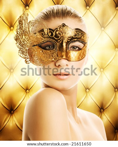 Beautiful woman in carnival mask over abstract background - stock photo