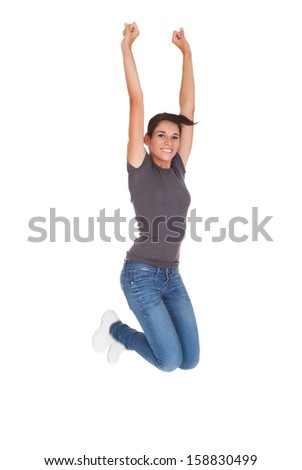 Beautiful Woman In Casual Wear Raising Arm Over White Background - stock photo