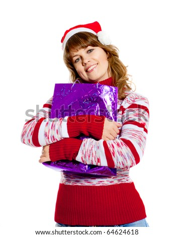 beautiful woman in christmas hat with emotion on her face - stock photo