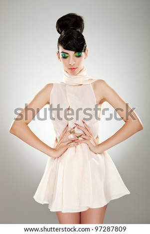 Beautiful woman in classical dress pose in studio. Vogue style photo. - stock photo