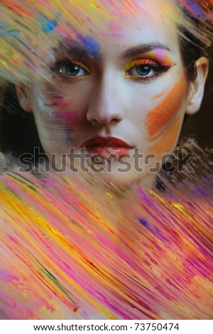 beautiful woman in color paint - stock photo