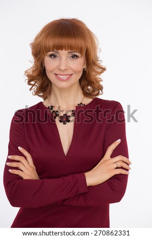 Beautiful woman in dark red colored dress on white - stock photo