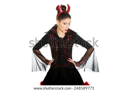 Beautiful woman in devil carnival costume. - stock photo