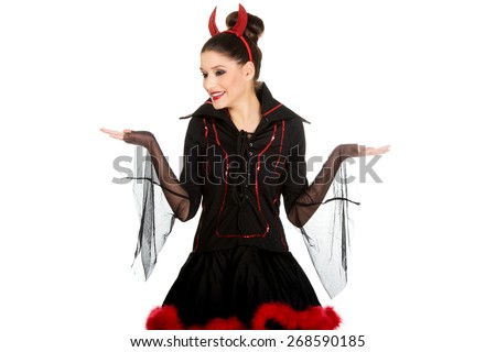 Beautiful woman in devil carnival costume with empty hands. - stock photo
