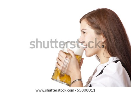 Beautiful woman in dirndl cloth holds Oktoberfest beer stein.Isolated on white background.